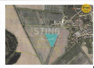 Pozemek pro komerci, Kožušany-Tážaly - fotografie č. 1
